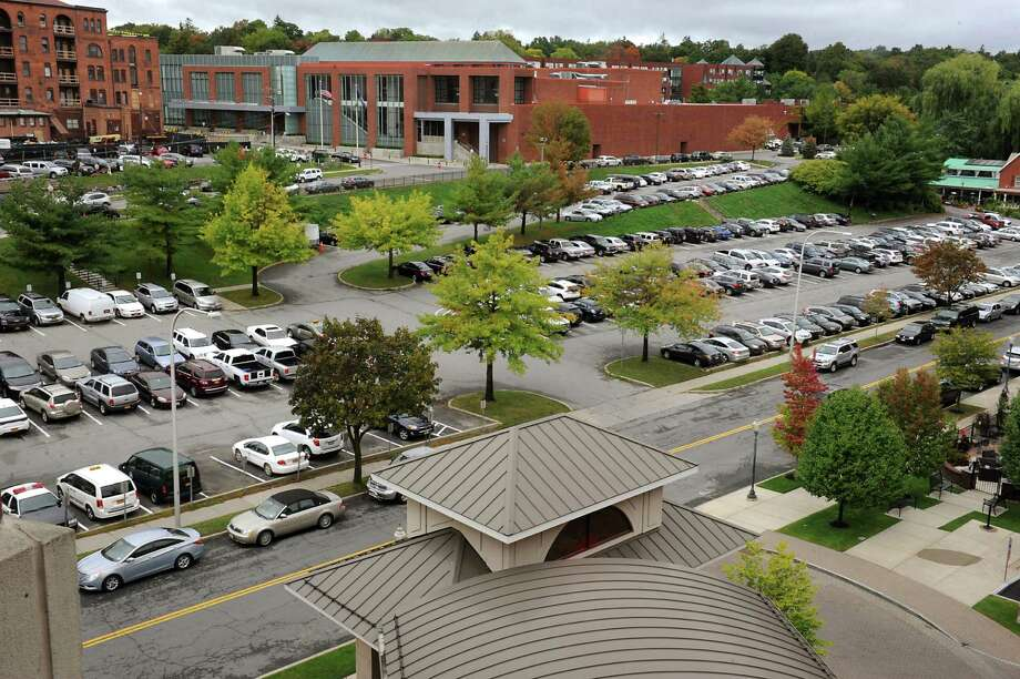 "City-owned parking lot between High Rock Avenue and Maple Avenue on Wednesday, Sept. 30, 2015 in Saratoga Springs , N.Y. Paramount Realty Group LLC proposes ""Highrock Village"" for two parking lots along High Rock, Maple and Lake avenues. It and The Community Builders, which has an office in Albany, submitted a joint response to a Request for Proposals (RFP) issued by the city to develop the 2.62 acres behind City Hall. (Lori Van Buren/Times Union archive) Photo: Lori Van Buren / 10033571A"