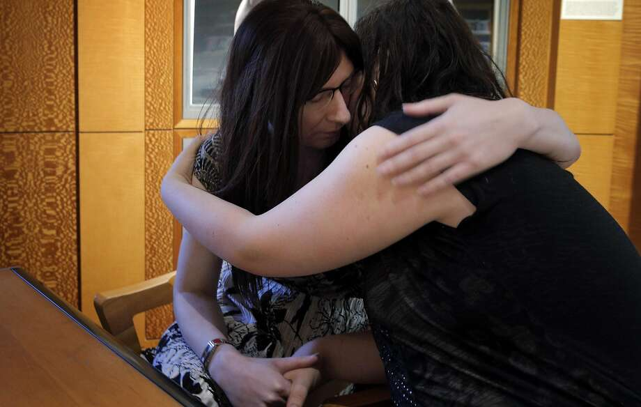 Samantha Hulsey, right, hugs her fiancee Daira Hopwood, left, both transgender women, were attacked by what police are calling a hate crime in San Francisco, Calif., on Monday, November 16, 2015. Samantha emerged with a black eye, some upper body pain and swelling to her face and neck from the incident. Photo: Carlos Avila Gonzalez, The Chronicle