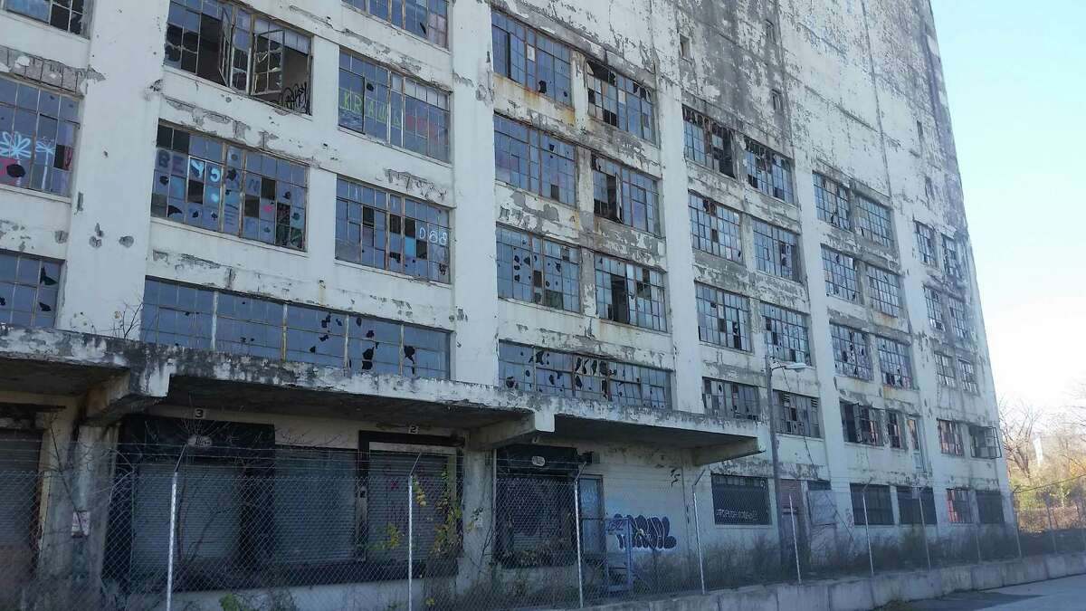 The lower floors of the Central Warehouse at Colonie and Montgomery streets are marred by broken windows and graffiti. (Photo by Chris Churchill / Times Union)