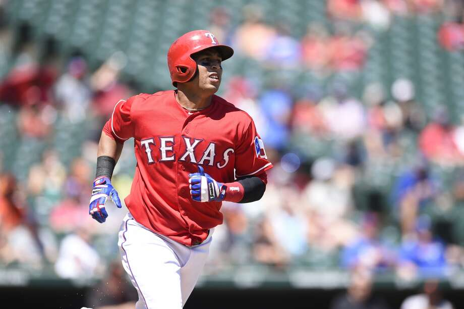 ARLINGTON, TX - Leonys Martin #2 runs to first base after hitting the ball in the game against the San Francisco Giants at Globe Life Park in Arlington on August 2, 2015 in Arlington, Texas. The Texas Rangers defeated the San Francisco Giants 2-1. (Photo by John Williamson/MLB Photos via Getty Images)