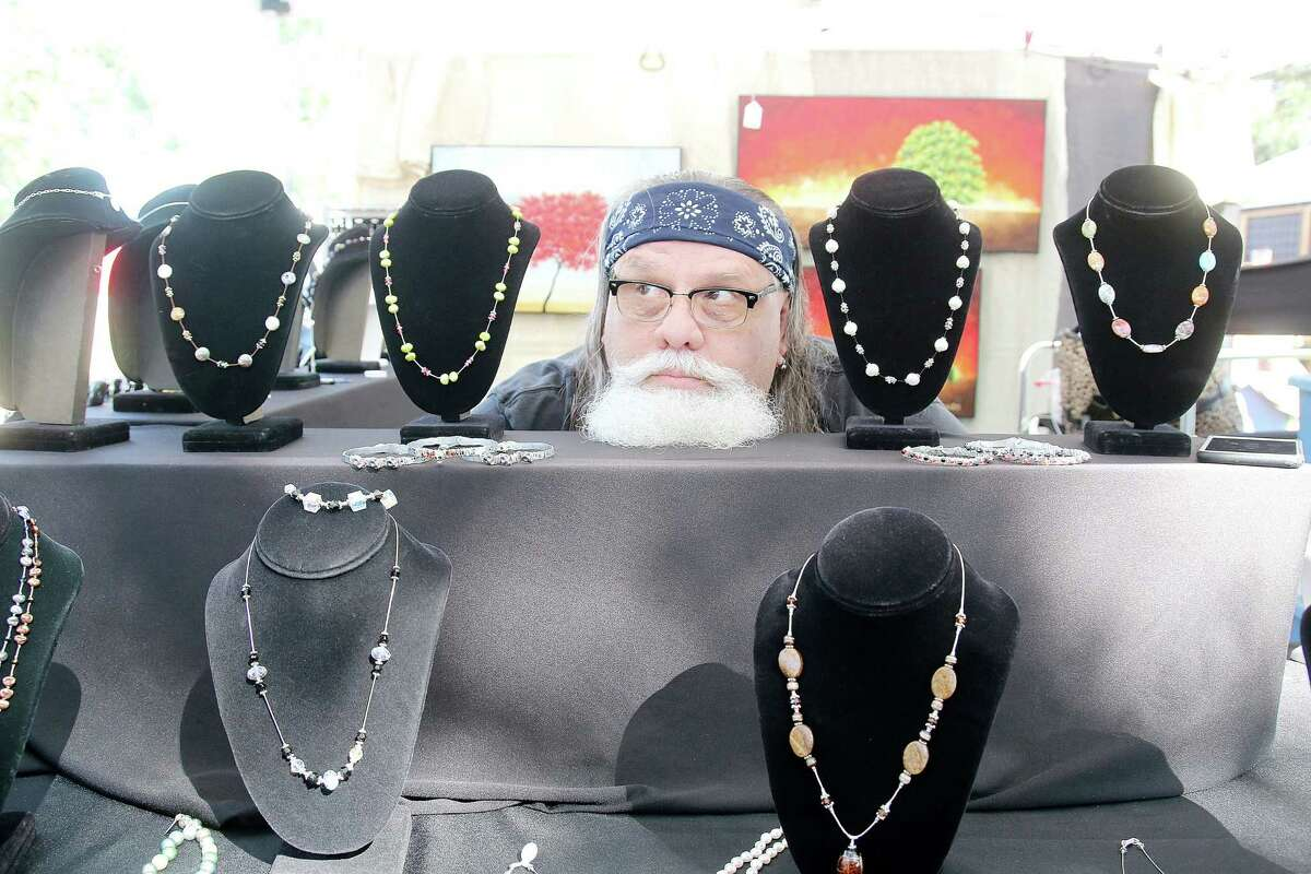 Steve Sellers of Tic Jewelry Design poses for a picture at The 6th annual Friendswood Art in the Park Festival.