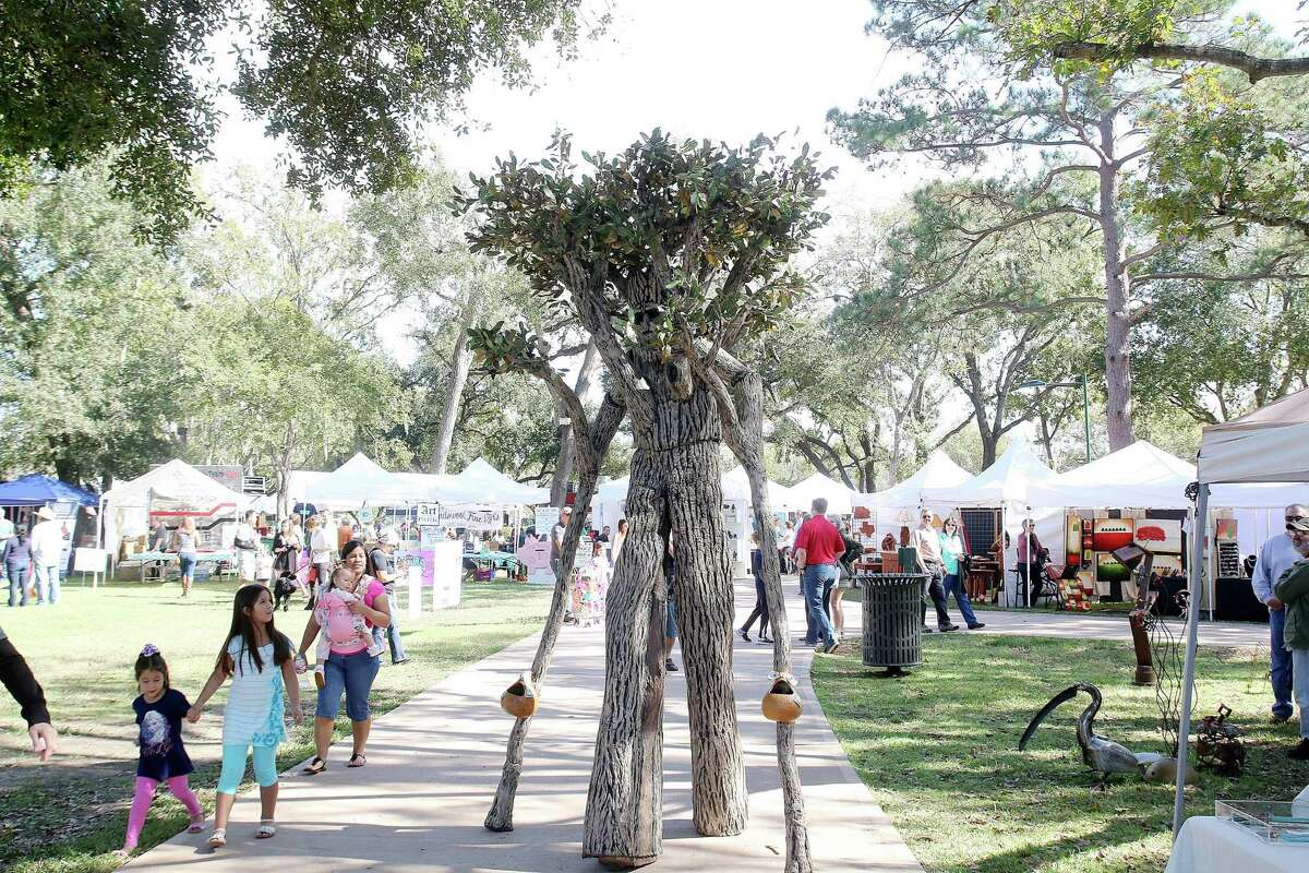 The Walking Tree of Life hangs out with revelers at the 6th annual Friendswood Art in the Park Festival.