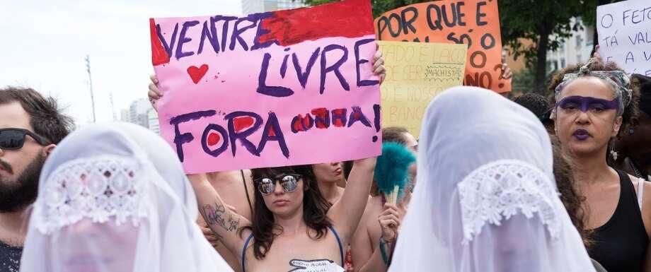 "Women take part in the ""Slutwalk"" against the president of the Brazilian Chamber of Deputies Eduardo Cunha at Copacabana beach in Rio de Janeiro, Brazil on November 14, 2015. Photo: CHRISTOPHE SIMON, AFP/Getty Images"