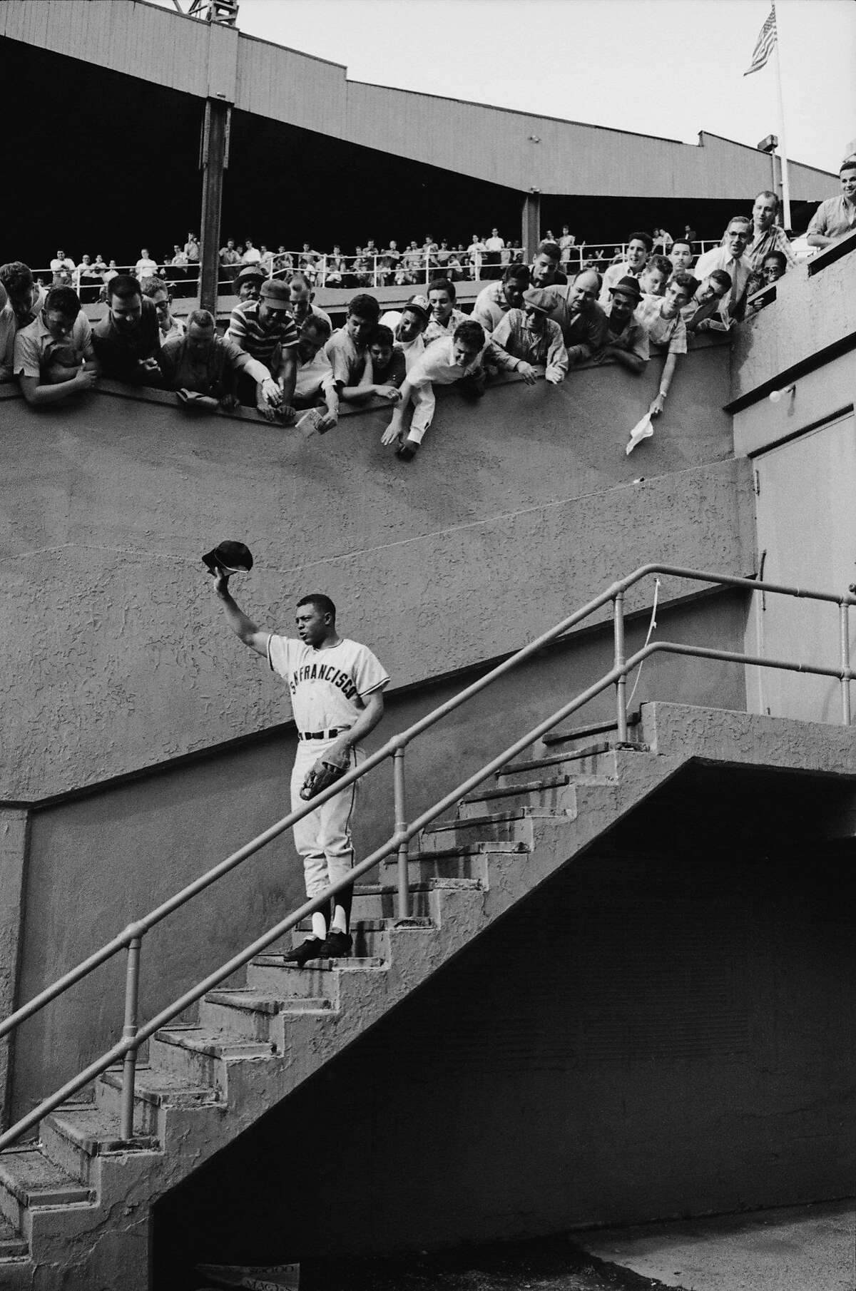 Fans welcoming Giants star Willie Mays at Polo Grounds.