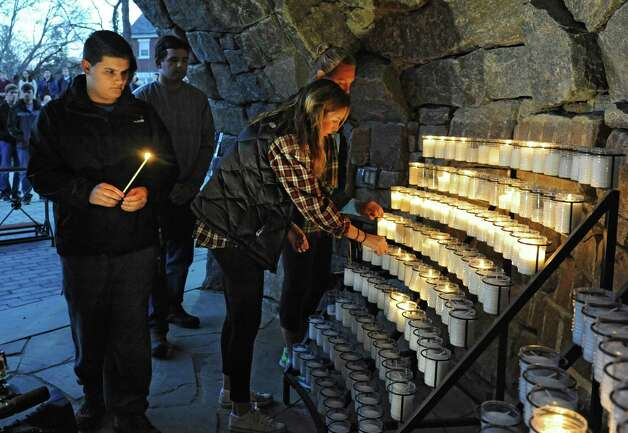 Siena students light candles in the campus grotto as Siena College host a vigil for the victims of the Paris attack on Monday, Nov. 16, 2015 in Loundonville, N.Y. (Lori Van Buren / Times Union) Photo: Lori Van Buren, Albany Times Union / 00034287A