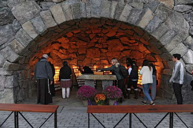 Siena students and faculty light candles in the campus grotto as Siena College host a vigil for the victims of the Paris attack on Monday, Nov. 16, 2015 in Loundonville, N.Y. (Lori Van Buren / Times Union) Photo: Lori Van Buren, Albany Times Union / 00034287A