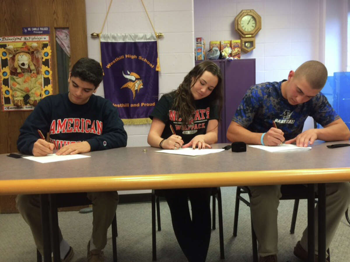 Matt Conte, Rachel Burston and Johnny Spoto sign National Letters of Intent at Westhill on Thursday.