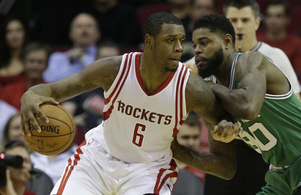 Houston Rockets Terrence Jones is guarded by Boston Celtics Amir Johnson during the first half of NBA game at Toyota Center Monday, Nov. 16, 2015, in Houston. ( Melissa Phillip / Houston Chronicle )