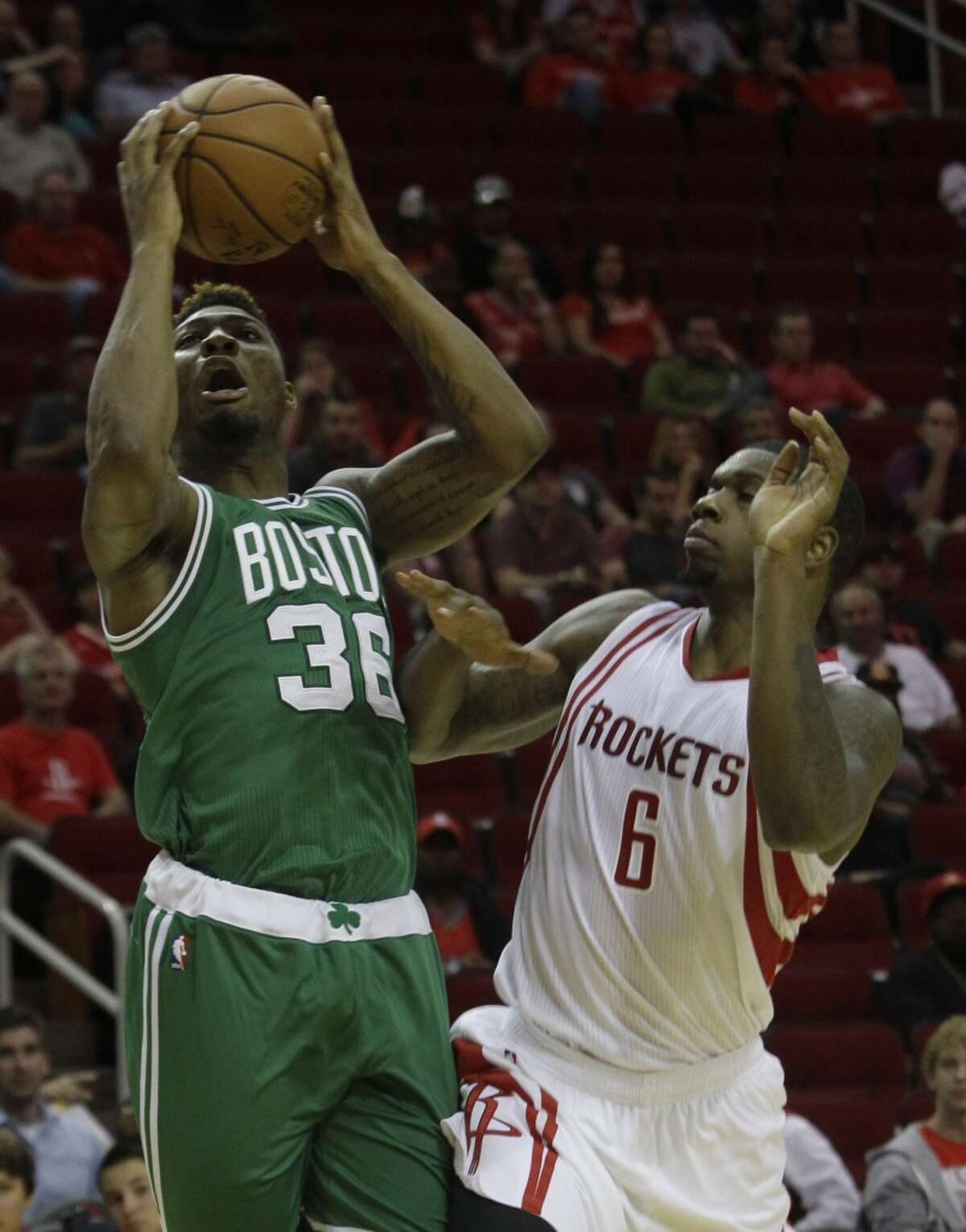 Boston Celtics Marcus Smart is fouled by Houston Rockets Terrence Jones during the first half of NBA game at Toyota Center Monday, Nov. 16, 2015, in Houston. ( Melissa Phillip / Houston Chronicle )