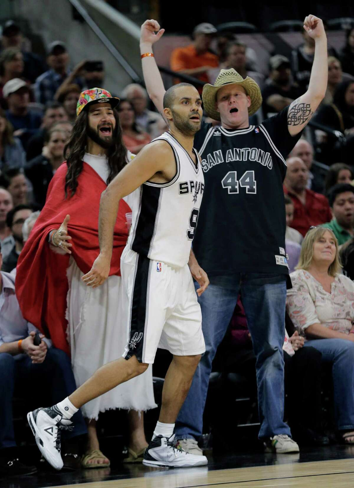 San Antonio Spurs' Tony Parker (9) watches his shot against the Portland Trail Blazers as San Antonio Spurs fans cheer behind him during the second half of an NBA basketball game against the Portland Trail Blazers, Monday, Nov. 16, 2015, in San Antonio. San Antonio Spurs won 93-80. (AP Photo/Eric Gay)