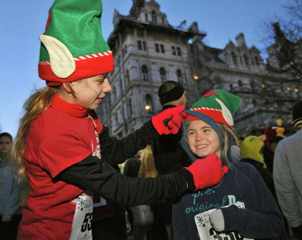 Runners and cousins Olivia Baumann,12, left, and Tess Fitzmaurice, 9, both of Greenville, ready for the the start of the 15th Annual Last Run 5K  race in Albany Saturday Dec. 17, 2011.    (John Carl D'Annibale / Times Union) Photo: John Carl D'Annibale / 00015785A