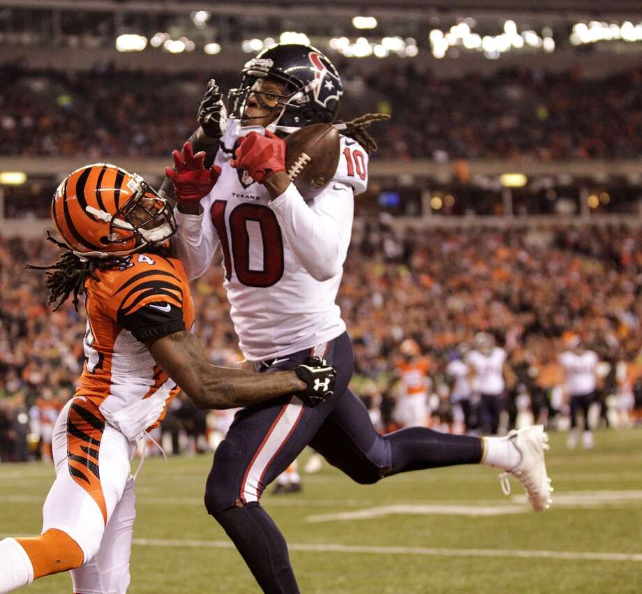 Houston Texans wide receiver DeAndre Hopkins (10) hauls in a long touchdown pass from QB T.J. Yates against Cincinnati Bengals cornerback Adam Jones (24) during the fourth quarter of an NFL football game at Paul Brown Stadium on Monday, Nov. 16, 2015, in Cincinnati. ( Brett Coomer / Houston Chronicle ) Photo: Brett Coomer, Houston Chronicle