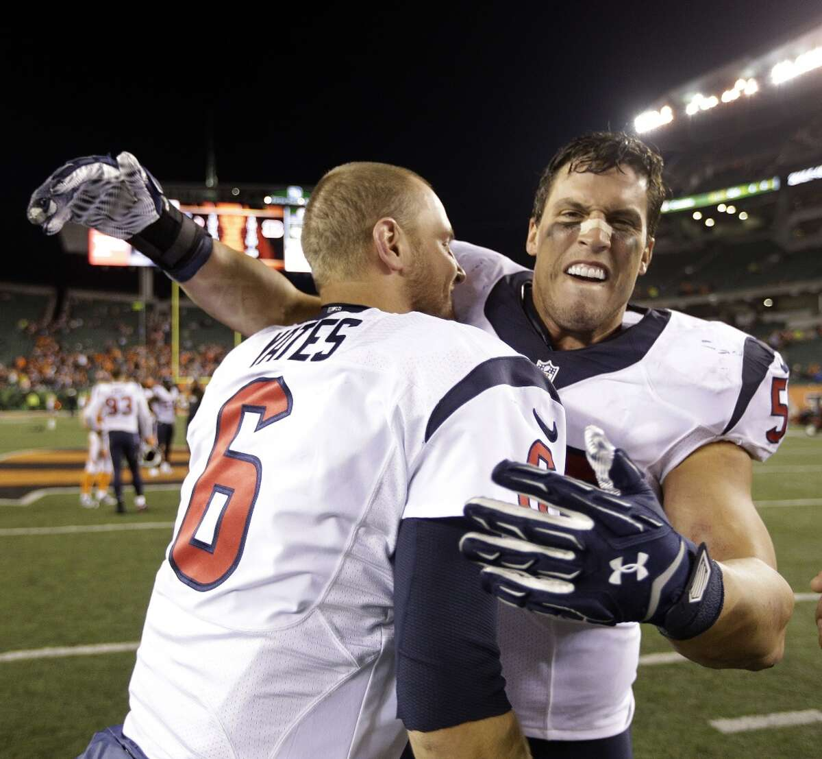 Houston Texans backup QB T.J. Yates (6) and inside linebacker Brian Cushing (56) celebrate the Texans 10-6 win over the Bengals during an NFL football game at Paul Brown Stadium on Monday, Nov. 16, 2015, in Cincinnati. ( Brett Coomer / Houston Chronicle )
