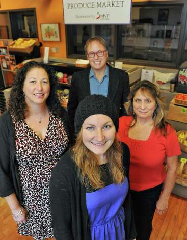 Employees, from left, executive director Amy Klein, Grow Center planner Matt Schueler, marketing coordinator Becky Whalen and program manager Sharon DiLorenzo pose at the produce market at Capital Roots Tuesday Nov. 10, 2015 in Troy, NY.  (John Carl D'Annibale / Times Union) Photo: John Carl D'Annibale / 00034165A