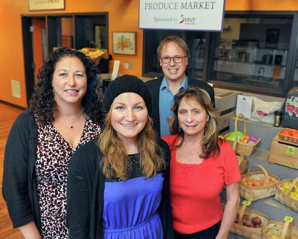 Employees, from left, executive director Amy Klein,  marketing coordinator Becky Whalen, Grow Center planner Matt Schueler, and program manager Sharon DiLorenzo pose at the produce market at Capital Roots Tuesday Nov. 10, 2015 in Troy, NY.  (John Carl D'Annibale / Times Union) Photo: John Carl D'Annibale / 00034165A