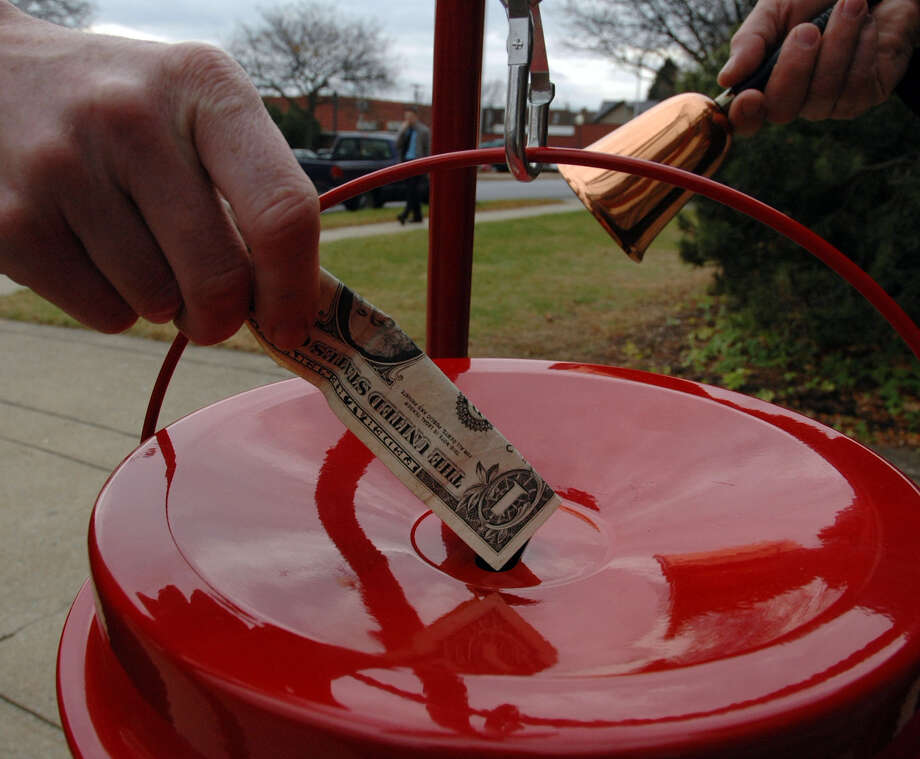 FILE — A person donates to the Salvation Army. Photo: John Carl D'Annibale / Albany Times Union