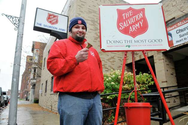 Salvation Army volunteer, Brian Bennett, Sr., of Troy poses with a red kettle outside the Salvation Army on  Wednesday, Nov. 11, 2015, in Troy, N.Y.   (Paul Buckowski / Times Union) Photo: PAUL BUCKOWSKI / 00034100A