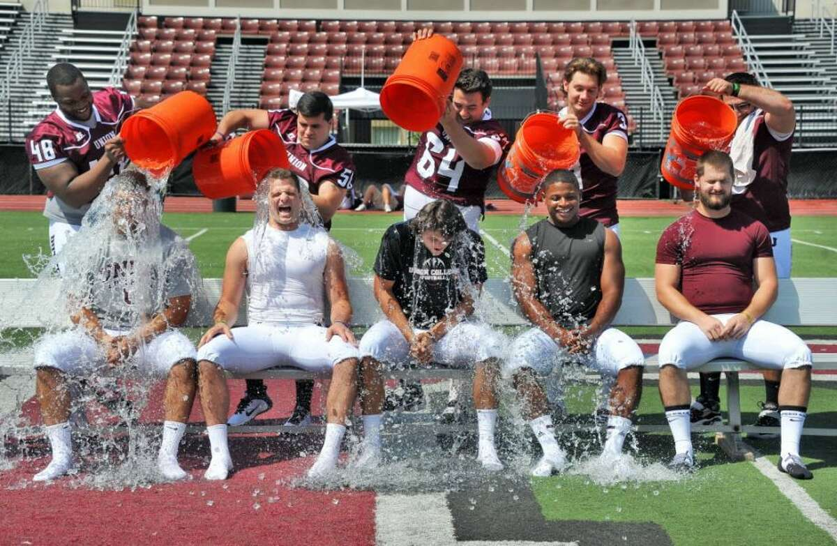 Union football captains, from left, Nick Pierce, Andrew Luzzi, quarterback Connor Eck, Darnell Thomas and Dylan Schuck take the ice bucket challenge during Union College Football media day Tuesday August 26, 2014, in Schenectady, NY.