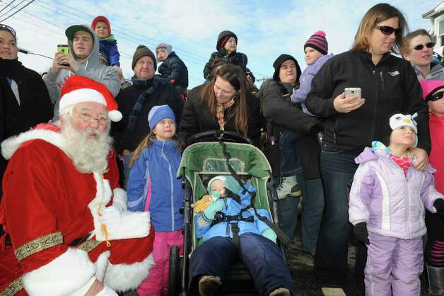 Santa, left, watches with the crowd as The Canadian Pacific Holiday Train of Lights arrives on Saturday Nov. 29, 2014 in Fort Edward, N.Y. (Michael P. Farrell/Times Union) ORG XMIT: MER2015110615134157 Photo: Michael P. Farrell / 00029574A