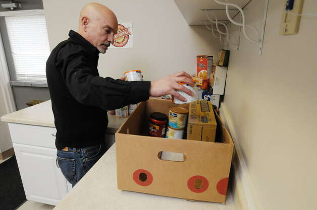 Volunteer Dave Cleveland sorts food donations at the Food Pantries for the Capital District on Wednesday, March 26, 2014 in Albany, N.Y. (Paul Buckowski / Times Union)