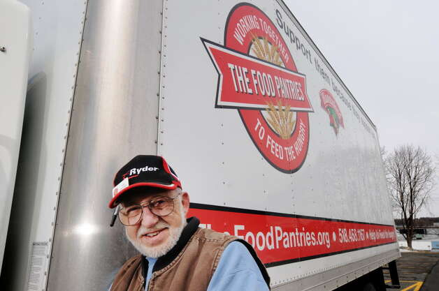 Lee Sweeney, a driver for the Food Pantries for the Capital District, poses by the truck he uses to pick up and deliver donated food on Wednesday, March 26, 2014 in Albany, N.Y. (Paul Buckowski / Times Union)