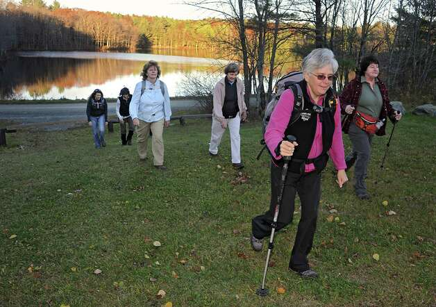 Dorothy Surprise, foreground, leads a group of people for a walk in Grafton Lakes State Park as part of a meetup on Wednesday, Nov. 4, 2015 in Grafton, N.Y.  (Lori Van Buren / Times Union) Photo: Lori Van Buren / 00034068A