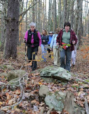 Dorothy Surprise, left, leads a group of people for a walk in Grafton Lakes State Park as part of a meetup on Wednesday, Nov. 4, 2015 in Grafton, N.Y.  (Lori Van Buren / Times Union) Photo: Lori Van Buren / 00034068A