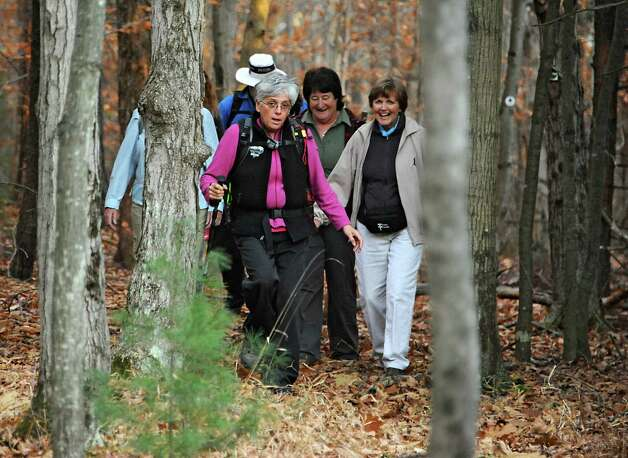 Dorothy Surprise, center, leads a group of people for a walk in Grafton Lakes State Park as part of a meetup on Wednesday, Nov. 4, 2015 in Grafton, N.Y.  (Lori Van Buren / Times Union) Photo: Lori Van Buren / 00034068A