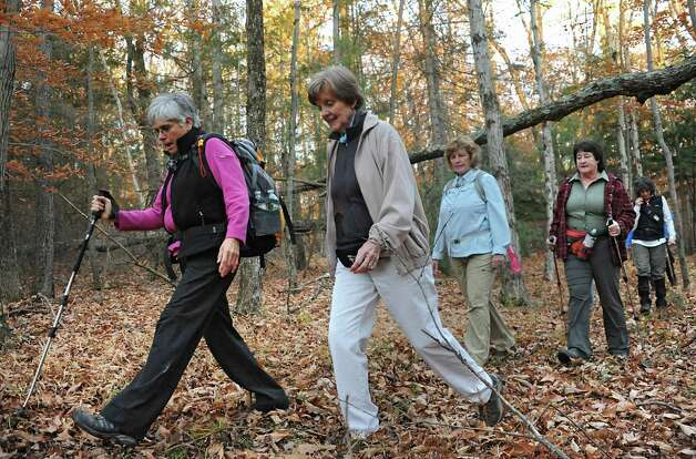Dorothy Surprise, left, leads a group of people including, from left, June Van Ness of East Greenbush, Cheryl Bielkiewicz of Latham, Shelly Sheehy of Latham and Amy Hudson of Latham for a walk in Grafton Lakes State Park as part of a meetup on Wednesday, Nov. 4, 2015 in Grafton, N.Y.  (Lori Van Buren / Times Union) Photo: Lori Van Buren / 00034068A