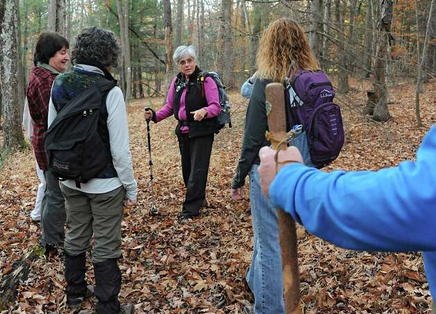 Dorothy Surprise, center, talks to a group of people as they walk in Grafton Lakes State Park as part of a meetup on Wednesday, Nov. 4, 2015 in Grafton, N.Y.  (Lori Van Buren / Times Union) Photo: Lori Van Buren / 00034068A