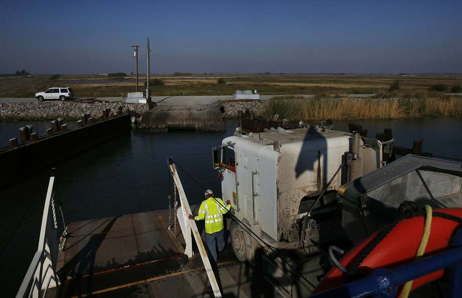 Larry Etherton prepares to unload a transport truck from a ferry to Webb Tract island near Rio Vista. Photo: Leah Millis, The Chronicle