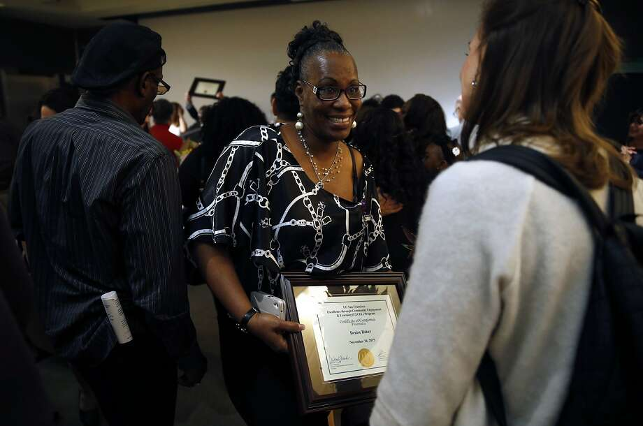 Denise Baker shows off her EXCEL Certificate of Completion after graduation ceremony at Genentech Hall on UCSF's Mission Bay campus in San Francisco, Calif., on Monday, November 16, 2015. Photo: Scott Strazzante, The Chronicle