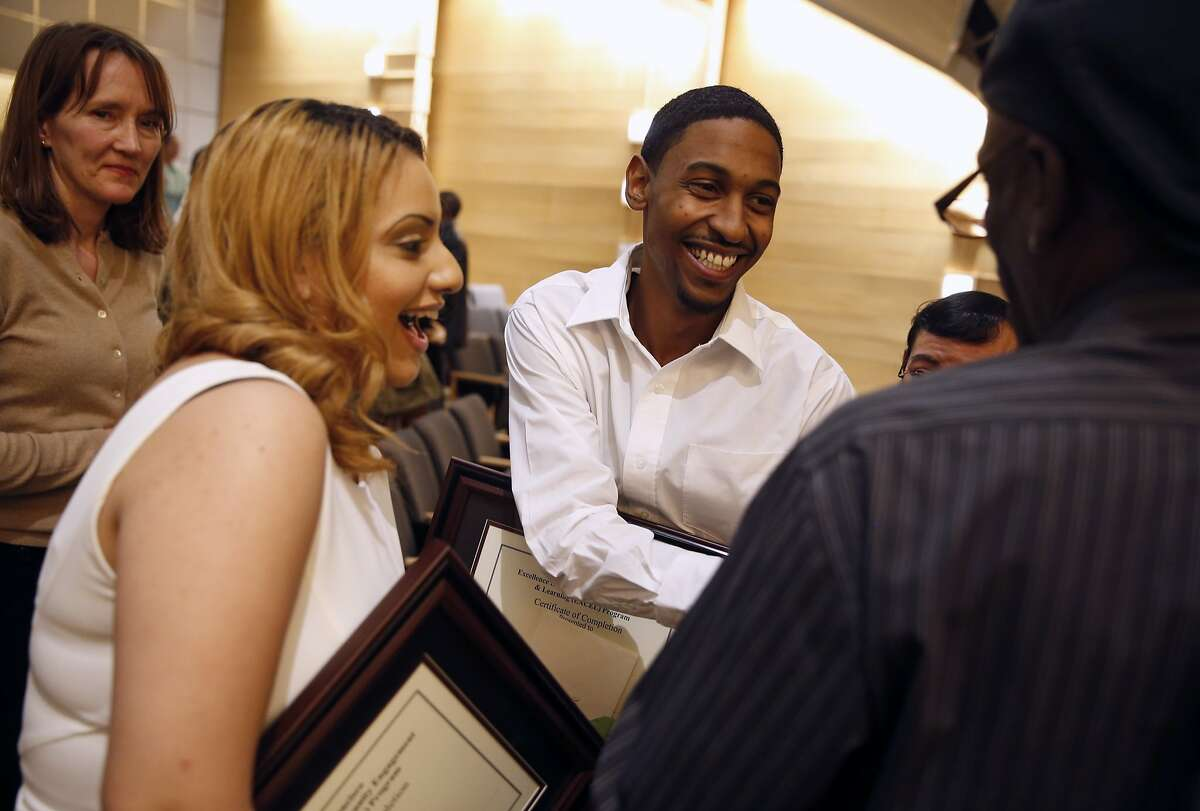EXCEL graduates Jasmine Morales and Nicholas Dupas are congratulated after graduation ceremony at Genentech Hall on UCSF's Mission Bay campus in San Francisco, Calif., on Monday, November 16, 2015.