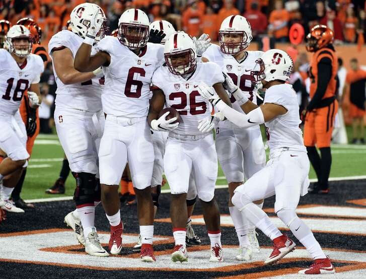 CORVALLIS, OR - SEPTEMBER 25: Running back Barry Sanders #26 of the Stanford Cardinal celebrates with his teammates after scoring a touchdown in the third quarter of the game against the Oregon State Beavers at Reser Stadium on September 25, 2015 in Corvallis, Oregon. (Photo by Steve Dykes/Getty Images)
