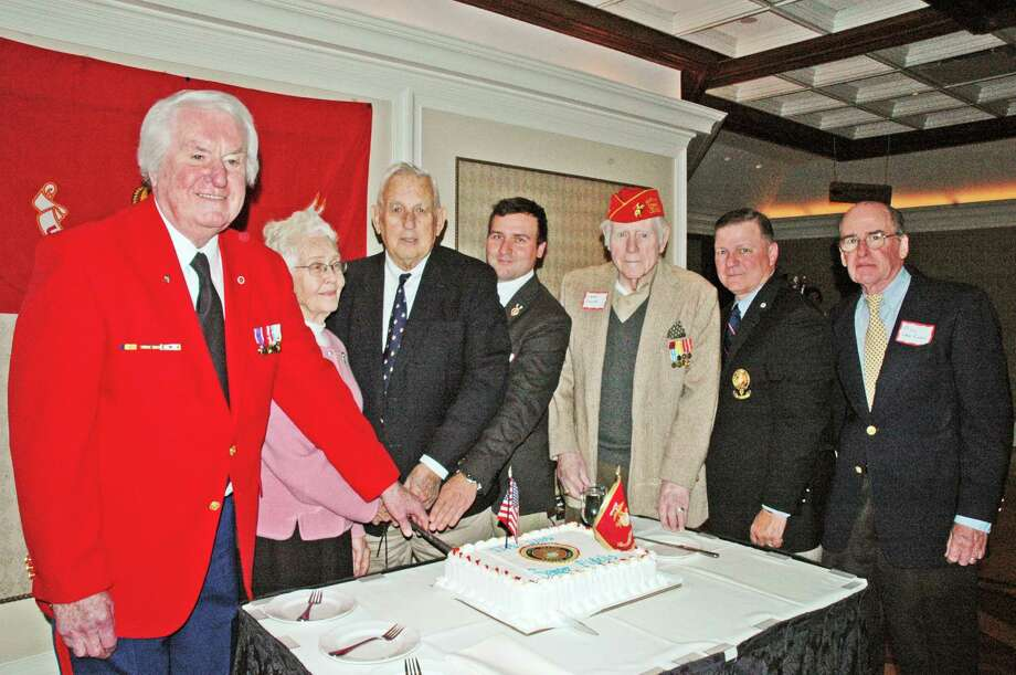 Leathernecks of Connecticut gathered at Giovanni's restaurant in Darien to celebrate the 240th birthday of the U.S. Marine Corps. In keeping with Marine Corps tradition, Dick Crowley, the officer in charge, served the first pieces of birthday cake to Gene Coyle and Mark Watros, the oldest and youngest marines at the luncheon. Taking part in the ceremony are, from left, Jack Harakal, of Stamford; Wilma Deicas, of New Canaan; Dick Crowley, of New Canaan; Mark Watros, of Darien; Gene Coyle, of Darien; John Campbell, of Norwalk; and Bill Van Loan, of Darien. Proceeds go to the Marine Corps Scholarship Foundation, a non-profit organization that grants education tuition to marines and dependents of marines on the basis of merit and need. Photo: Contributed / Contributed Photo / Darien News