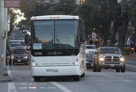 A commuter bus arrives at Van Ness Avenue and McAllister Street in San Francisco, Calif. to pick up LinkedIn employees and shuttle them to Mountain View on Tuesday, Nov. 17, 2015