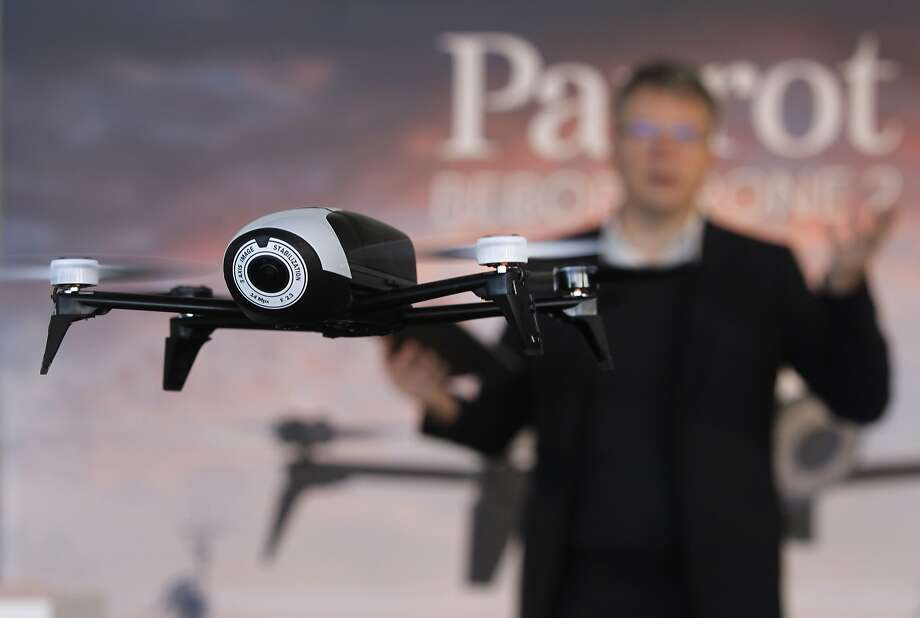 Parrot CEO Henri Seydoux demonstrates his company's Bebop Drone 2, basically a video camcorder with four propellers. Photo: Paul Chinn, The Chronicle