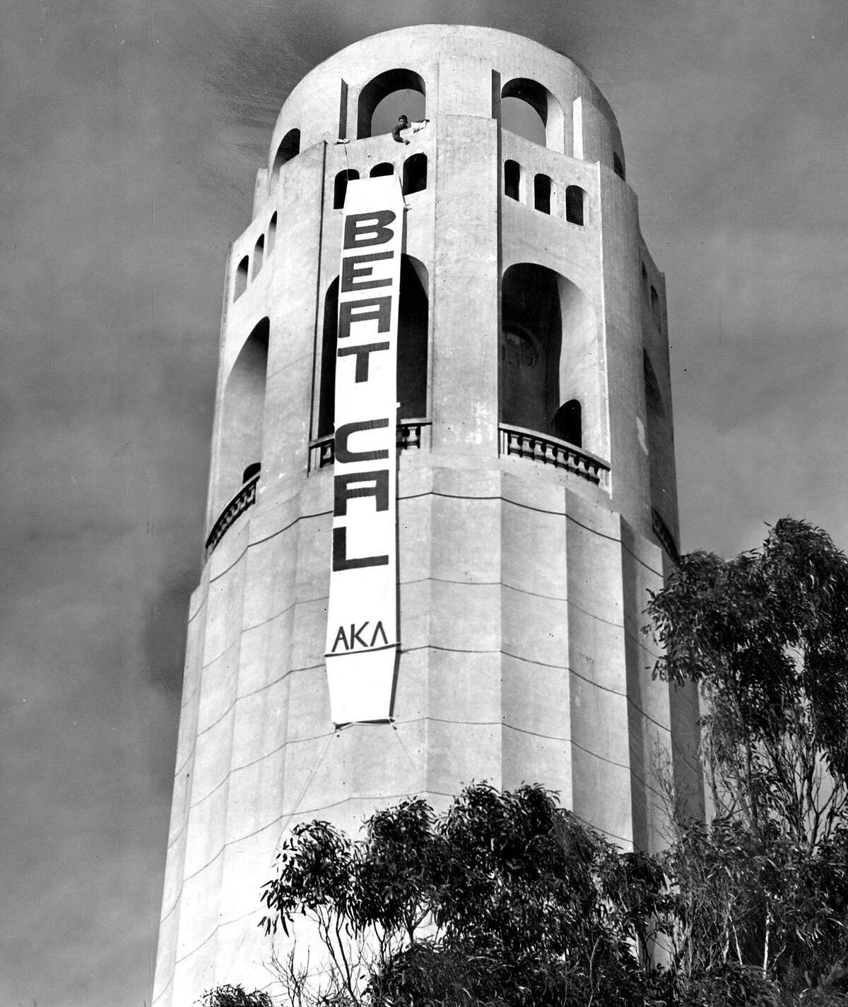"""Nov. 17, 1963 (Stanford 28, Cal 17): Stanford fans drape a """"Beat Cal"""" sign off the Coit Tower."""