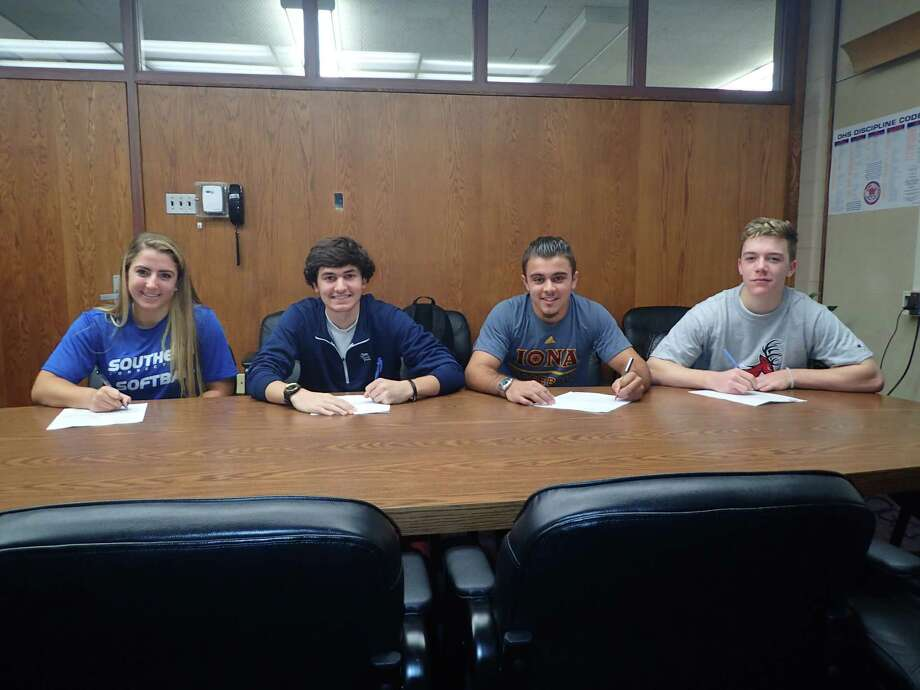 Four Danbury High School athletes finalized their college plans during the school's fall signing-day ceremony on Tuesday, Nov. 17, 2015. Pictured are, from left, Julia Lener (Southern Connecticut, softball); Andy Stock (Monmouth, golf); Jason Goetz (Iona, baseball) and Eric Cerno (Fairfield, baseball). Photo: Rich Gregory / Rich Gregory / News-Times