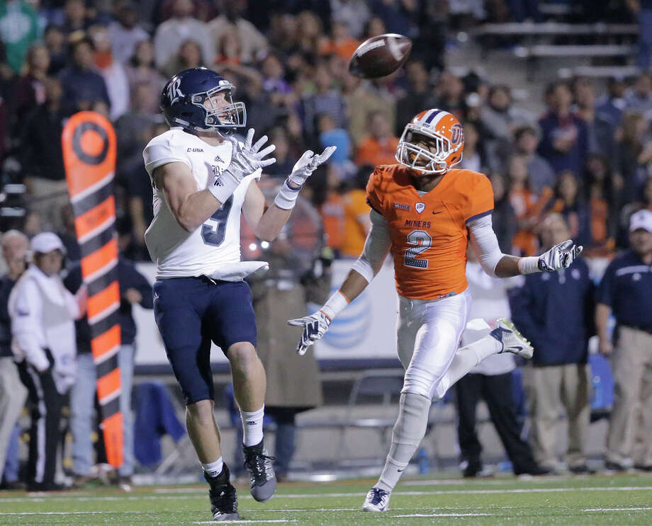 Rice wide receiver Zach Wright catches a touchdown pass past UTEP defensive back Ishmael Harrison during the first half of an NCAA college football game Friday, Nov. 6, 2015, in El Paso, Texas. (Mark Lambie/El Paso Times via AP) Photo: MARK LAMBIE, MBI / El Paso Times