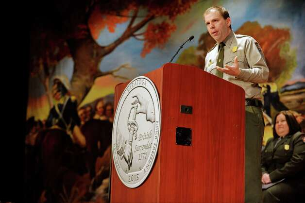 Saratoga National Historical Park ranger and historian, Eric Schnitzer, talks about the importance of the British surrender at Saratoga during an event by the U.S. Mint to unveil the coin Honoring Saratoga National Historical Park on Tuesday, Nov. 17, 2015, at Schuylerville High School in Schuylerville, N.Y.  The new coin is part of the U.S. Mint's America the Beautiful Quarters Program.  (Paul Buckowski / Times Union) Photo: PAUL BUCKOWSKI / 00034051A