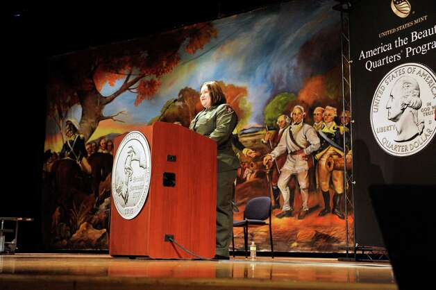 Saratoga National Historical Park superintendent Amy Bracewell addresses those gathered during an event by the U.S. Mint to unveil the coin Honoring Saratoga National Historical Park on Tuesday, Nov. 17, 2015, at Schuylerville High School in Schuylerville, N.Y.  The new coin is part of the U.S. Mint's America the Beautiful Quarters Program.  (Paul Buckowski / Times Union) Photo: PAUL BUCKOWSKI / 00034051A