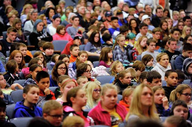 High school students, staff and guests watch during an event by the U.S. Mint to unveil the coin Honoring Saratoga National Historical Park on Tuesday, Nov. 17, 2015, at Schuylerville High School in Schuylerville, N.Y.  The new coin is part of the U.S. Mint's America the Beautiful Quarters Program.  (Paul Buckowski / Times Union) Photo: PAUL BUCKOWSKI / 00034051A