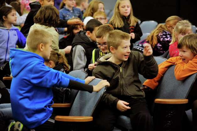 Fourth grade students look over the new coins they were given at an event by the U.S. Mint to unveil the coin Honoring Saratoga National Historical Park on Tuesday, Nov. 17, 2015, at Schuylerville High School in Schuylerville, N.Y.  The new coin is part of the U.S. Mint's America the Beautiful Quarters Program.  (Paul Buckowski / Times Union) Photo: PAUL BUCKOWSKI / 00034051A