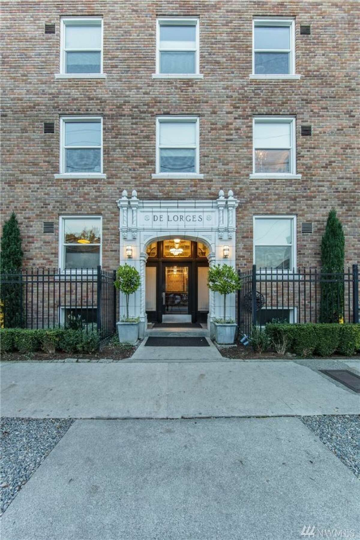 The first condo, #501 in 325 Harvard Ave. E., is listed for $255,000. The 477 square-foot unit is in a vintage building constructed in 1928. It features 10-foot-high ceilings and rounded arch doorways. You can see the full listing here.