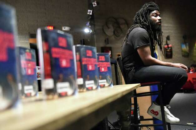 Jason Reynolds of Brooklyn, an award-winning writer of young adult books, presents his books and life story to student on Tuesday, Nov. 17, 2015, at Albany High in Albany, N.Y. (Cindy Schultz / Times Union) Photo: Cindy Schultz / 00034265A