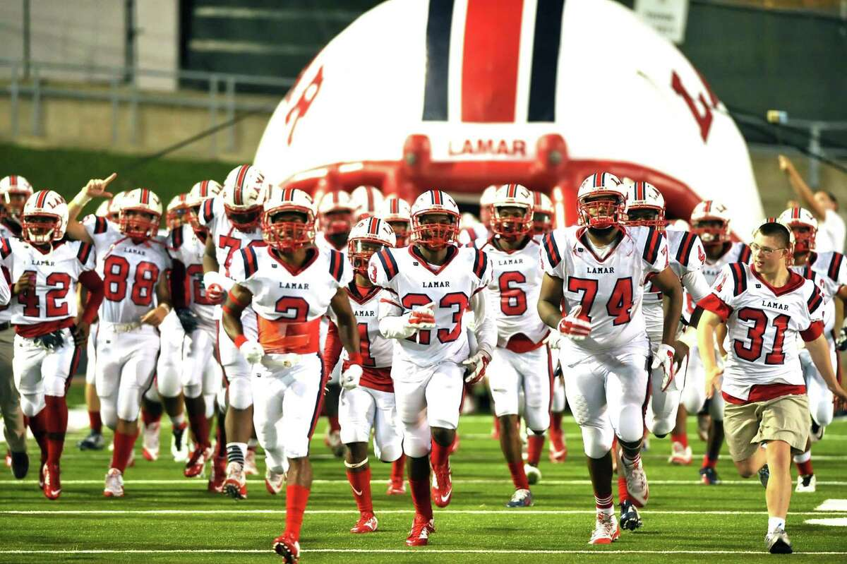 Lamar High School's football team defeated Westside, 59-0, at Delmar Stadium, 11-6-2015. The LamarTexans take the field for the game against Westside.