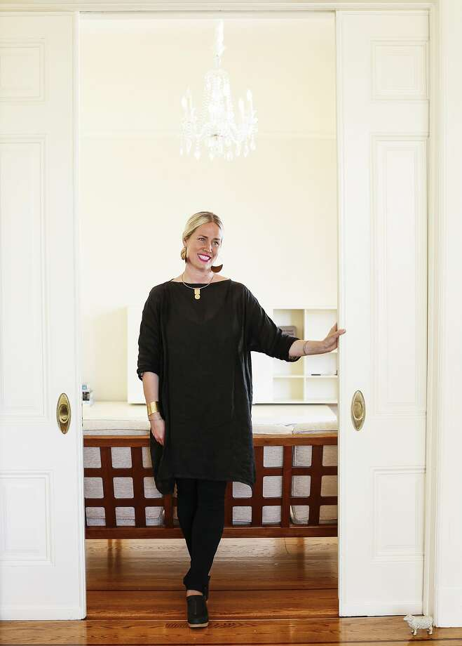 Heidi Swanson welcomes guests to her Alamo Square flat. Photo: Russell Yip, The Chronicle