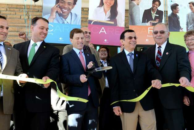 Greg Schahet, president and CFO of Schahet Hotels, center left, and  Schahet Hotels CEO Jeffery Brown, center right, take part in a ribbon cutting event to make the opening of the new Doubletree Hotel by Hilton at 100 Nott Terrace Tuesday, Nov. 17, 2015, in Schenectady, N.Y. (Will Waldron/Times Union) Photo: Will Waldron / 10034298A