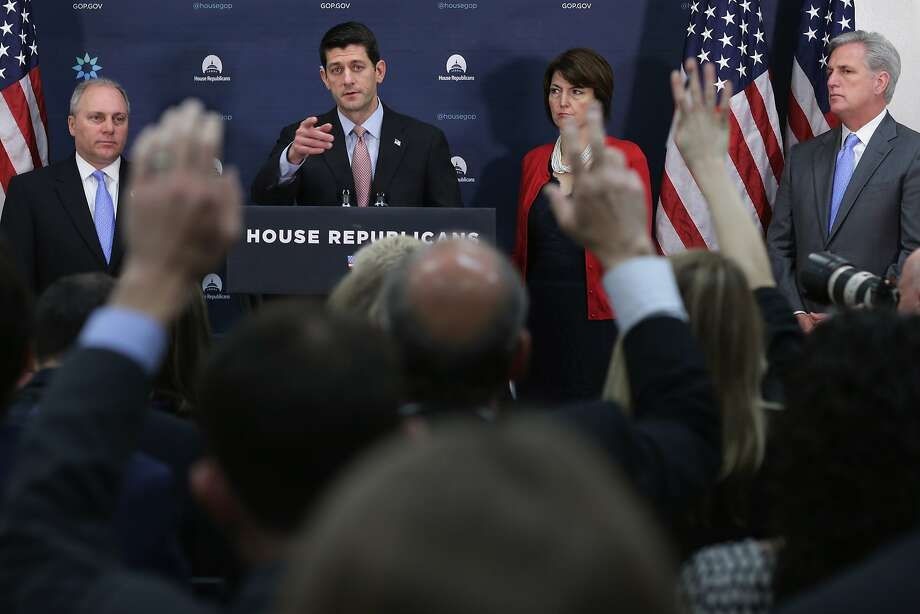 House Speaker Paul Ryan (at podium) answers reporters' questions during a news briefing with Majority Whip Steve Scalise, Rep. Cathy McMorris Rogers and Majority Leader Kevin McCarthy after the Republican Conference meeting on refugees. Photo: Chip Somodevilla, Getty Images